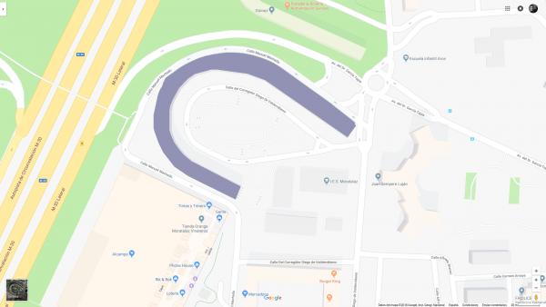 plano de la zona y edificio marcado con violeta para que destaque su forma